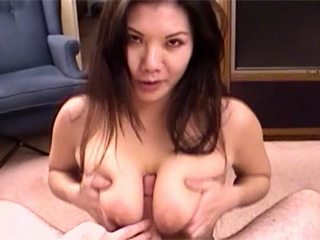 Stripped to the waist Chinese chubby doll performs Tit Job